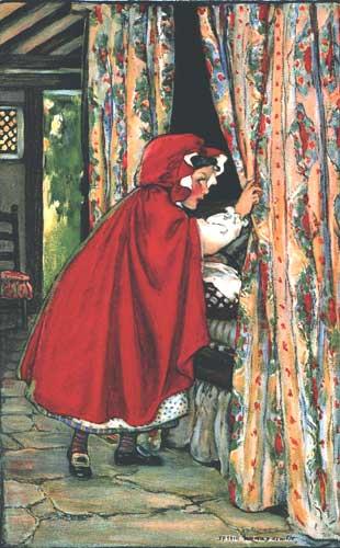Rotkäppchen schaut ins Bett der Großmutter. Illustration von Jessie Willcox Smith